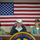 US President Donald Trump and First Lady Melania Trump meet with US Virgin Islands Governor Kenneth Mapp (unseen) in the Ward Room aboard the USS Kearsarge, off Puerto Rico on October 3, 2017. Nearly two weeks after Hurricane Maria thrashed through the US territory, much of the islands remains short of food and without access to power or drinking water. / AFP PHOTO / MANDEL NGANMANDEL NGAN/AFP/Getty Images