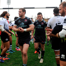 Dejected: Ulster players trudge off after their loss in Parma