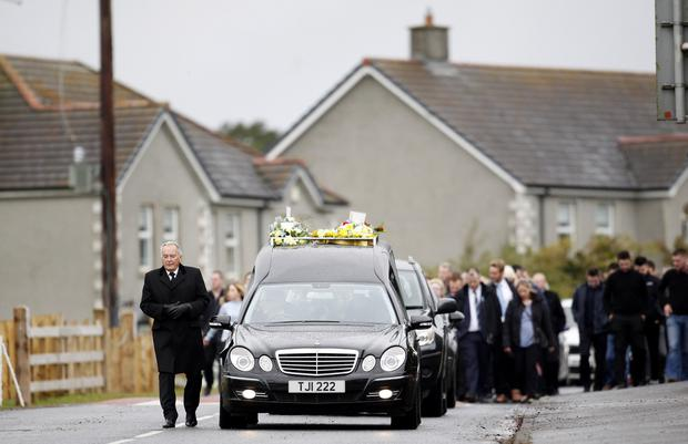 The hearse carrying the coffin of Stephen Wilkinson makes its way to The Church of The Blessed Sacrament Mullinahoe for burial. Stephen died as a result of a road traffic accident. Pic by Peter Morrison