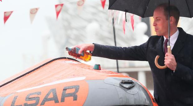 The Duke of Cambridge names a life boat The Ray of Hope, for Lagan Search and Rescue, a rescue and lifeboat service that covers the Belfast Harbour Estate, River Lagan and the estuarial waters of Belfast Lough, in the Titanic Quarter, as part of his tour of Belfast. PRESS ASSOCIATION Photo. Brian Lawless/PA Wire