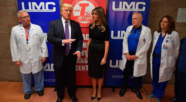 US President Donald Trump along with First Lady Melania Trump speaks to the press after visiting with staff and shooting survivors at University Medical Center in Las Vegas, Nevada on October 4, 2017. / AFP PHOTO / Mandel NGANMANDEL NGAN/AFP/Getty Images
