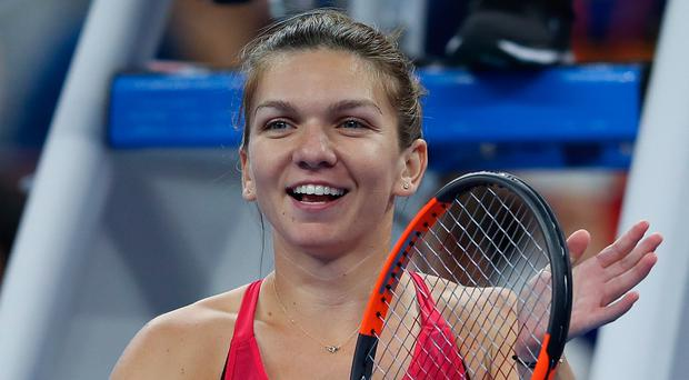 Simona Halep of Romania claim a first ever win over Maria Sharapova at the China Open