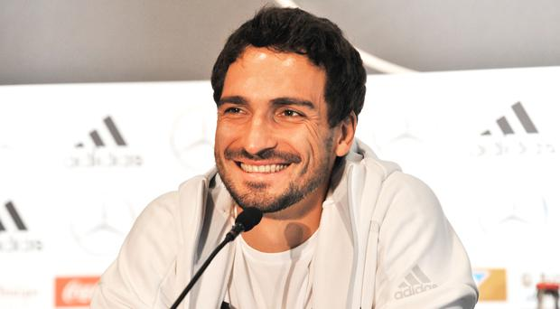 Hum-dinger: Germany star Mats Hummels, pictured at Stormont Hotel press conference last night, teased Northern Ireland fans with a tweet ahead of tonight's World Cup qualifier