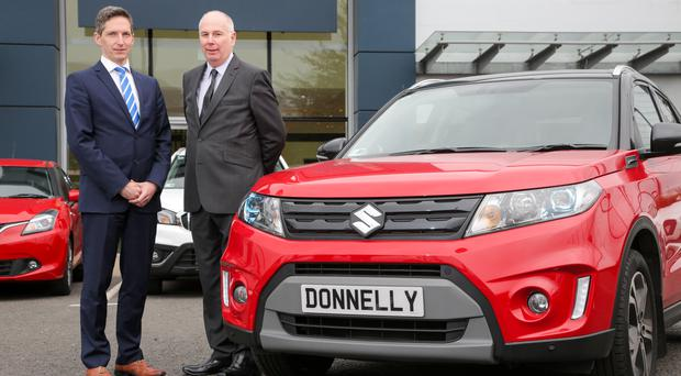 Paul Compton (left) and Stephen Robinson at the Donnelly Group Suzuki premises on Boucher Road