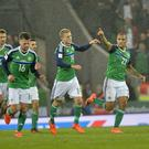 MARK MARLOW 05/11/2017. World cup qualifier for Russia 2018. Northern Ireland vs Germany at The National football stadium at windsor Park in Belfast. Pictured is Northern Ireland's Josh Magennis celebrating a goal during tonights game in Belfast. Picture Mark Marlow