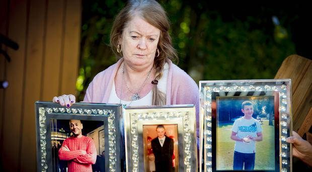 Patricia Ferrin grieves for her sons Stephen, Kieran and Niall