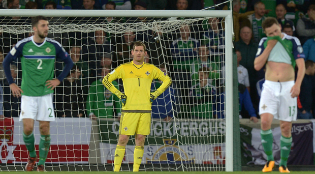 Unstoppable: Michael McGovern looks stunned after Germany pull 2-0 ahead