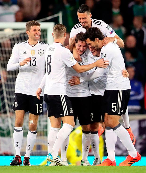 Sebastian Rudy takes the acclaim from his German teammates after scoring their opening goal