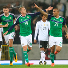 Final pointer: Josh Magennis hails his late strike in 3-1 defeat by Germany at Windsor last night