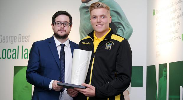 NIFWA Chairman Keith Bailie presents Knockbreda's Karl Hamill with the Championship Player of the Month award for September.