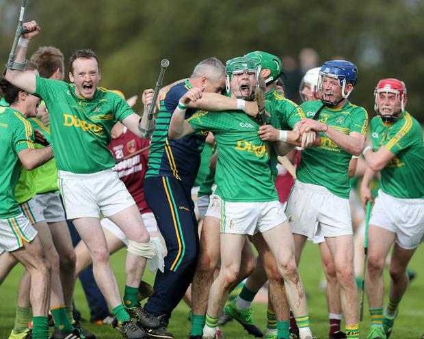 Players celebrate after their Antrim Senior Hurling Final win over Cushendall
