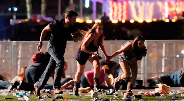 Lethal outcome: revellers run for cover during the shooting in Las Vegas