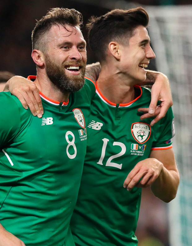 Republic of Ireland's Daryl Murphy (left) celebrates scoring his side's second goal. Photo: Brian Lawless/PA