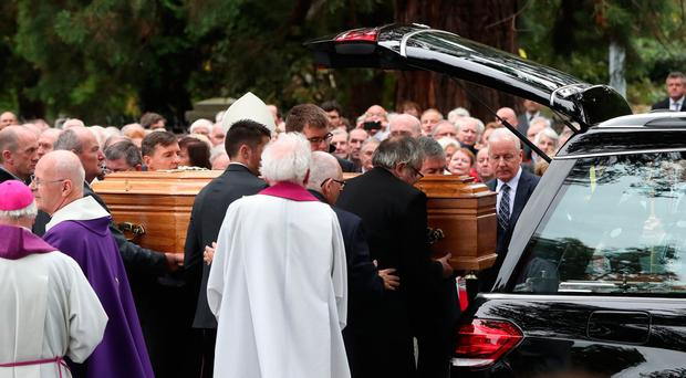 The coffin of former Irish taoiseach Liam Cosgrave is carried into the Church of the Annunciation in Rathfarnham in Dublin, after his funeral service. Pic Niall Carson/PA
