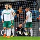 Northern Ireland's Chris Brunt (2nd right) looks dejected after scoring an own goal, giving Norway their first of the game during the 2018 FIFA World Cup Qualifying Group C match at the Ullevaal Stadion, Oslo. Martin Rickett/PA Wire.
