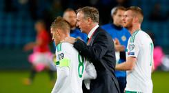 Northern Ireland manager Michael O'Neill (centre) with Steven Davis after the 2018 FIFA World Cup Qualifying Group C match at the Ullevaal Stadion, Oslo. Martin Rickett/PA Wire.