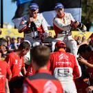 Celebration: Kris Meeke (right) and his co-driver Paul Nagle enjoy the spoils of victory after triumphing in the Rally Catalunya