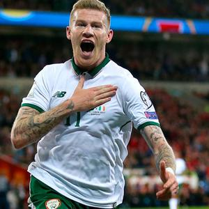 Republic of Ireland's James McClean celebrates scoring to send his side into the play-offs.