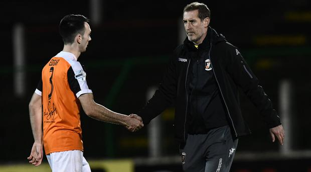 PACEMAKER BELFAST 10/10/2017 Glentoran v Carrick Rangers League Cup game Glentoran Manager Gary Haveron shakes hands with Carrick match winner Mark Edgar during this evenings game at the Oval in Belfast