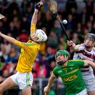 Get in: Slaughtneil's Brendan Rodgers scores a goal despite the efforts of Dunloy's Ryan Elliott and Kevin Molloy in Sunday's Ulster semi-final, which was watched by a big crowd