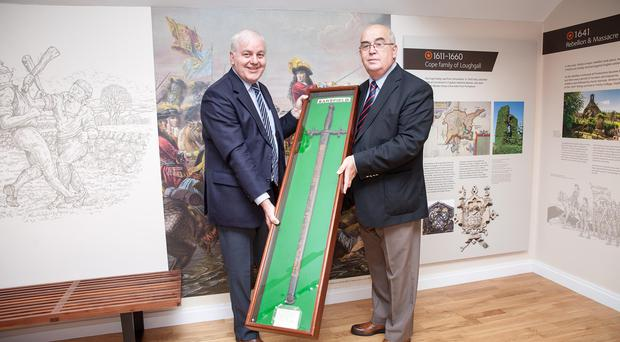 Co Armagh Grand Master Denis Watson (right) and county secretary, Roger Gardiner, with Sarsfield's sword which has gone on public display at the Museum of Orange Heritage, Loughgall / Credit: Graham Curry