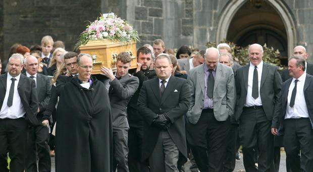 The funeral cortege of Natasha Carruthers leaves Rossorry Parish Church for burial in the adjoining cemetery