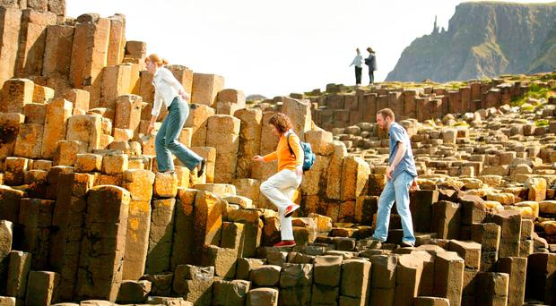 Tourists have been flocking to world famous sites including the Giant's Causeway and Titanic Belfast