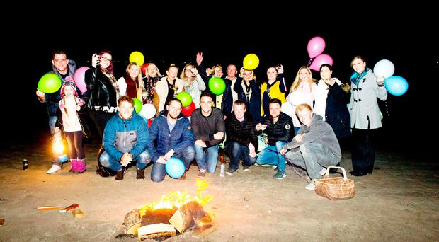 Friends and family light lanterns to remember Sherry Campbell, who tragically died last month