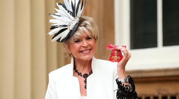 Broadcaster Gloria Hunniford is made an OBE by Queen Elizabeth II during an Investiture ceremony at Buckingham Palace, London. (Jonathan Brady/PA Wire)