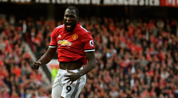 Red-hot: Romelu Lukaku is out to continue his purple patch against Jurgen Klopp's men