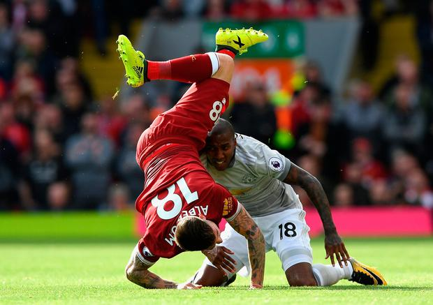 LIVERPOOL, ENGLAND - OCTOBER 14: Alberto Moreno of Liverpool and Ashley Young of Manchester United battle for possession during the Premier League match between Liverpool and Manchester United at Anfield on October 14, 2017 in Liverpool, England. (Photo by Shaun Botterill/Getty Images)