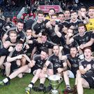 Champions: The Omagh team celebrate with the O'Neill Cup again after edging a dull decider against Errigal Ciaran at Healy Park
