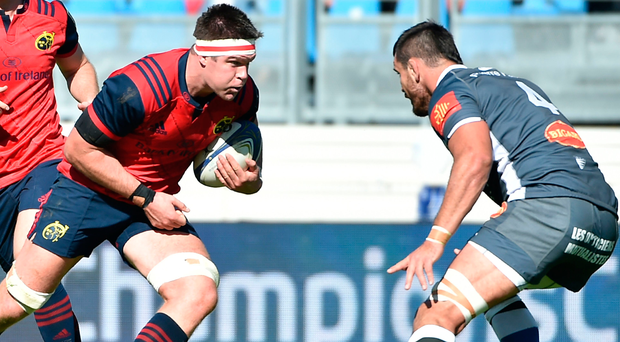 Running man: Munster's lock Billy Holland on the attack against Castres