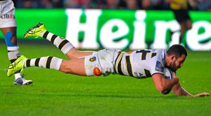 Just the ticket: La Rochelle's French centre Geoffrey Doumayrou dives over the line to score a try