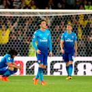 Late winner: Arsenal players look dejected after their injury-time defeat to Watford