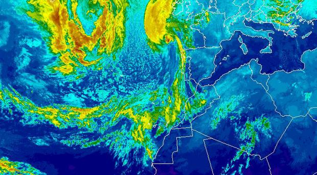This satellite image released by the National Oceanic and Atmospheric Administration shows Hurricane Ophelia, top center, on Sunday, Oct. 15, 2017, at 21:00 UTC. The remnants of Ophelia could bring 80 mile an hour (130 kilometer an hour) wind gusts, disruption and damage to Ireland and Britain as the work week gets underway, weather services said Sunday. (NOAA via AP)