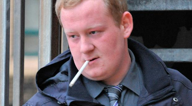 Ross Clarke leaves Antrim Crown Court after being given a two-year probation order for his trail of destruction in Larne
