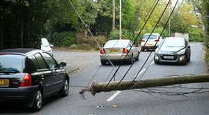 The clear up operation gets under way after Storm Ophelia, here power lined down on Upper Malone Road. Pic: Pacemaker
