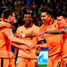 First of many: Roberto Firmino (second from right) takes the acclaim after opening the floodgates for Liverpool in Slovenia