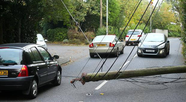 The clear up operation after Storm Ophelia, here power lined down on Upper Malone Road. Pacemaker