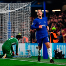 Get in: Eden Hazard after scoring Chelsea's second goal against Roma at Stamford Bridge last night