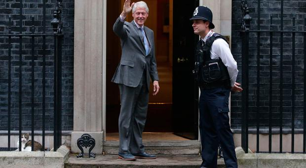 Former US President Bill Clinton waves as he arrives for meeting with British Prime Minister Theresa May at Downing street in London on October 19, 2017. / AFP PHOTO / Daniel LEAL-OLIVASDANIEL LEAL-OLIVAS/AFP/Getty Images