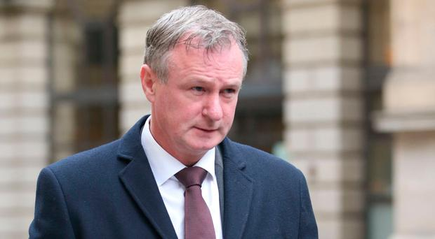 Northern Ireland football manager Michael O'Neill leaves Edinburgh Sheriff Court where he pleaded guilty to drink-driving. Jane Barlow/PA Wire