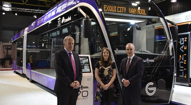 l-r Ciarán de Búrca, Director of Transport Projects, Department for Infrastructure, Cllr Nuala McAllister, Lord Mayor of Belfast and Chris Conway, Group Chief Executive, Translink unveil the new Belfast Rapid Transit Glider vehicle at Bus World in Belgium.