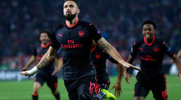 Arsenal's Olivier Giroud celebrates scoring his side's first goal of the game during the Europa League group H soccer match between Red Star and Arsenal (AP Photo/Darko Vojinovic)