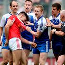 Heated: Tyrone's Tiernan McCann clashes with Colin Walshe of Monaghan, with the counties drawn together last night in Ulster