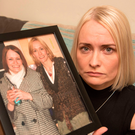 No respite: Denise Murray with a cherished picture of her and her twin sister Charlotte who disappeared in 2012