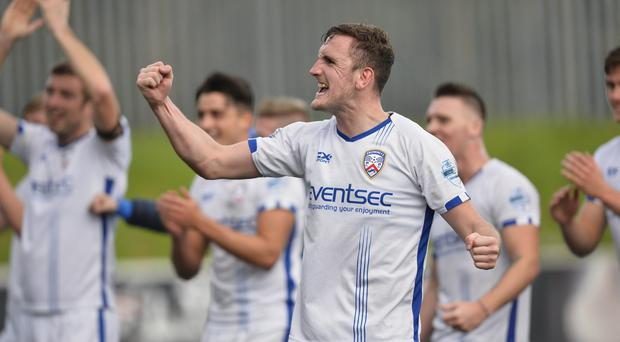 Coleraine's Stephen O'Donnell celebrates with the fans after the final whistle at Solitude. Photo Mark Marlow/Pacemaker Press