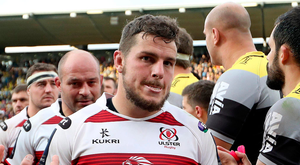 Dejected: Sean Reidy trudges off after Ulster's defeat