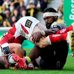 Sore point: Ulster's John Cooney is tackled by Botia Veivuke of La Rochelle